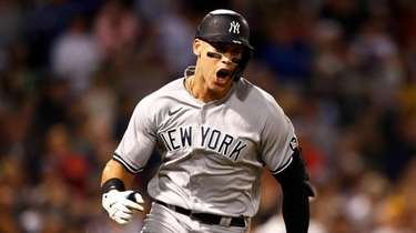 Aaron Judge of the Yankees reacts after hitting