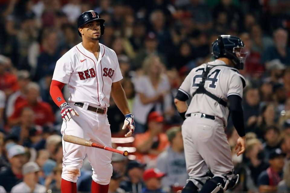 Boston Red Sox's Xander Bogaerts drops the bat