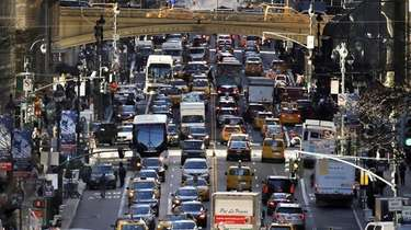 Traffic moves along 42nd Street in Midtown Manhattan,