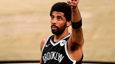 Kyrie Irving of the Brooklyn Nets acknowledges the