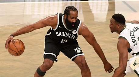 Brooklyn Nets guard James Harden is defended by