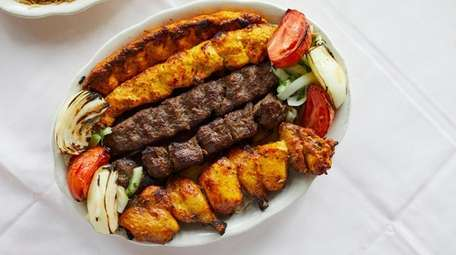 Mixed grilled kabobs served with rice at Afghan