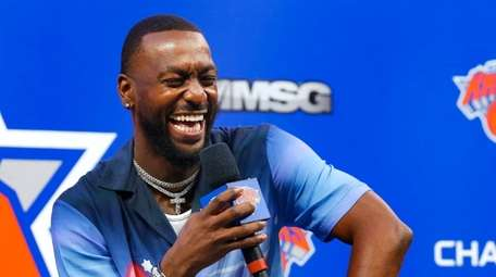 Knicks point guard Kemba Walker smiles during a