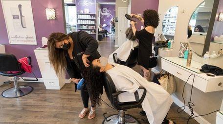 Senior Stylist Jessica Sotis cuts the hair of