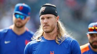 Noah Syndergaard #34 of the Mets looks on