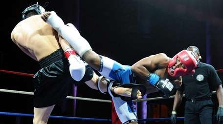 Phumi Nkuta, right, throws a kick to the