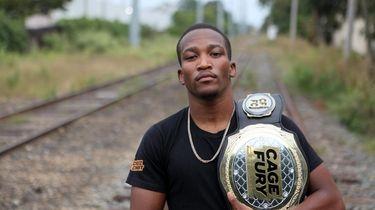Phumi Nkuta, who lives in Massapequa, poses with