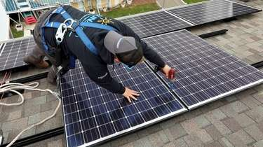 Installation of solar panels on the roof of