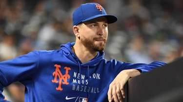 Mets pitcher Jacob deGrom looks on from the