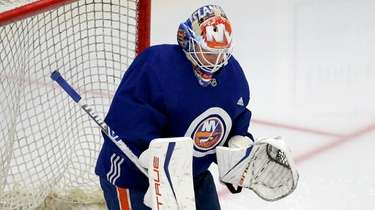 Islanders goalie Cory Schneider makes a save during