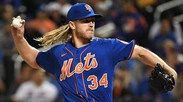 Mets pitcher Noah Syndergaard delivers against the Marlins