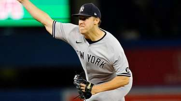 Yankees starting pitcher Jameson Taillon hrows against the