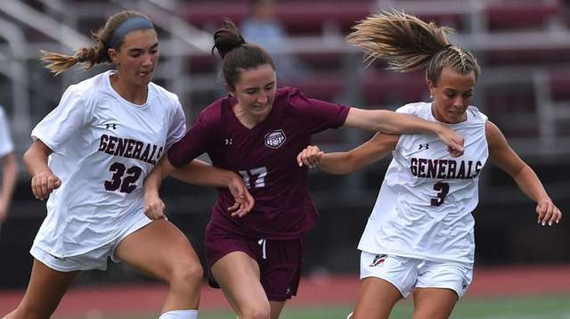 Catherine Hayes of Garden City, center, tries to