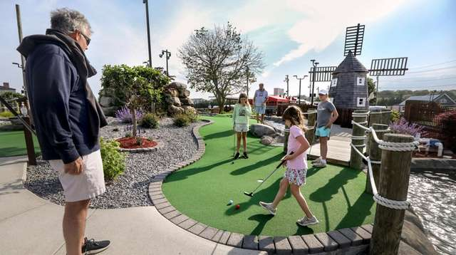 Families spend an afternoon on the miniature golf