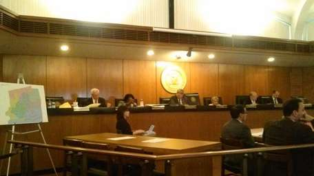 The Hempstead Town board listens to speakers during