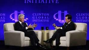 Former President Bill Clinton, left, and Comedy Central's