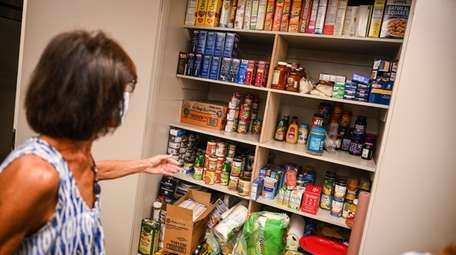 Donated food is stocked in the Social Action