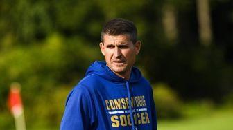 Comsewogue head coach, Justin Seifert, keeps an eye