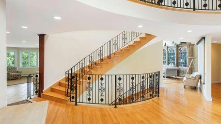 An intricate wrought iron railing runs along the