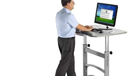 The TR1200-DT, a treadmill/desk combo with large armrests