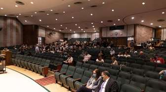 Students and parents at attend a meeting as