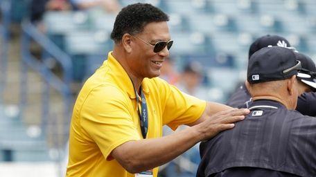 Yankees analyst Ken Singleton, left, watches batting practice