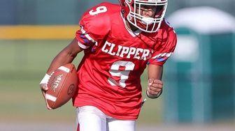 Bellport's Justin Miles (9) runs in a touchdown