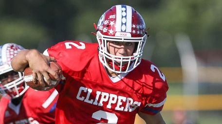 Bellport's Jack Halpin (2) runs in a touchdown