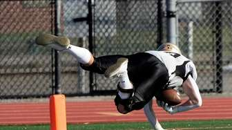 Wantagh's Sean Carlo's off balance dive for the
