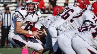 MacArthur quarterback Ryan Muller takes the snap during
