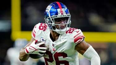 Giants running back Saquon Barkley carries in the