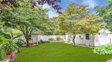 The 0.11-acre lot has a large fenced-in yard