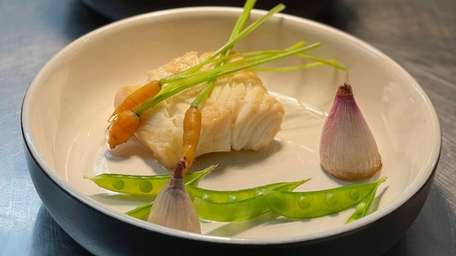 Among chef Alex Bujoreanu's creations are wild halibut