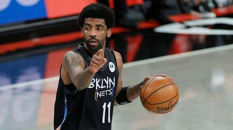 Kyrie Irving (11) of the Nets calls a