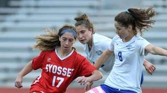 Mikayla Camp of Syosset races for control of