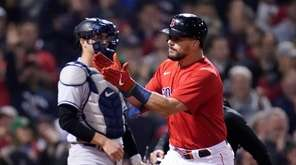 Boston Red Sox's Kyle Schwarber celebrates his solo