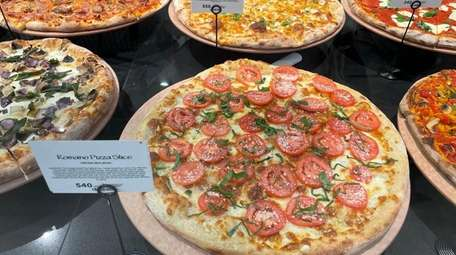 Customers can buy fresh pizzas to reheat at