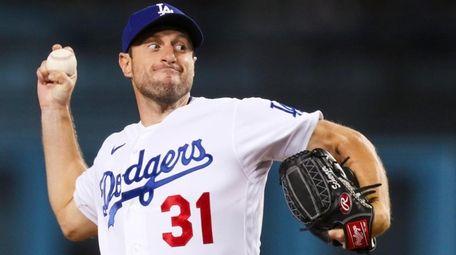 Dodgers starting pitcher Max Scherzer throws against the