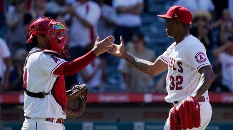 Angels catcher Kurt Suzuki, left, and relief pitcher