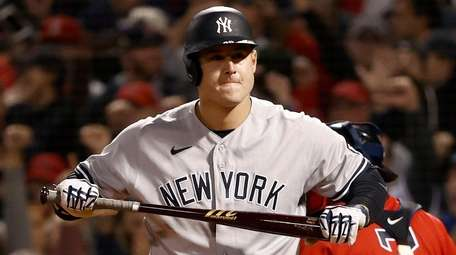 Anthony Rizzo of the Yankees reacts after striking
