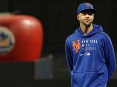 Jacob deGrom of the Mets looks on before