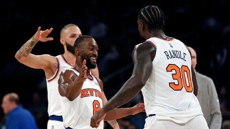 Knicks guard Kemba Walker (8) celebrates with forward