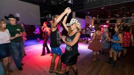Linda Lazarus, of Wantagh, 75, line dances with