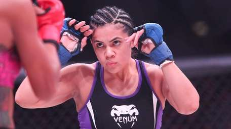 Jessica Ruiz of Baldwin, right, fights Jennifer Chieng