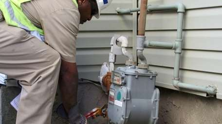 A National Grid worker turns the gas back