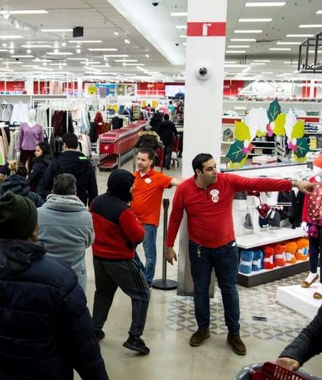 Employees direct November shoppers at the Westbury Target