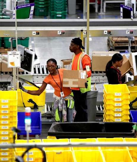 Workers at Amazon's Fulfillment Center on Tuesday, October