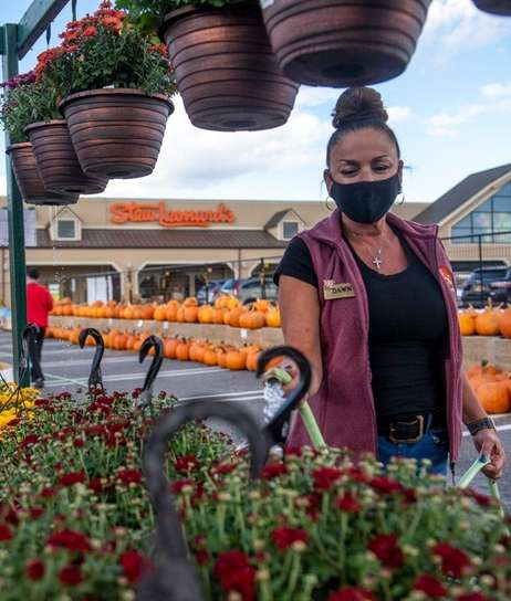 Dawn Levy Store Manager waters plants at Stew