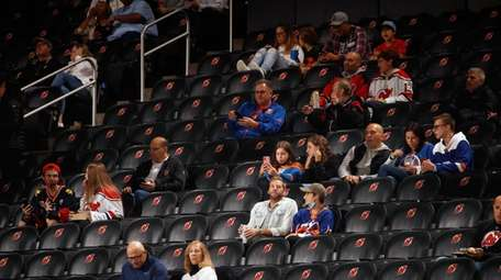 Fans wait in their seats during a partial