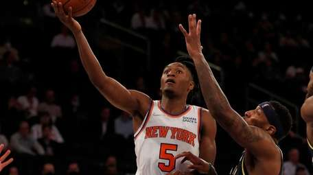 Immanuel Quickley #5 of the Knicks goes to